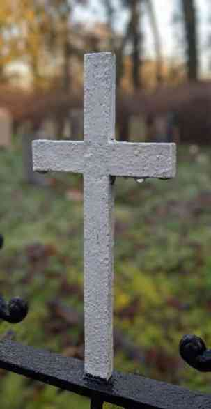 A cross on the gate where Lori saw the legs and boots