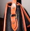 Dooney and Bourke All-Weather Leather Handbag characteristics