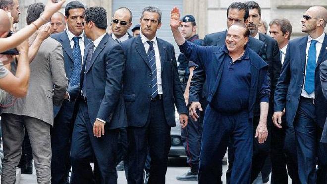 20140328-Berlusconi-scorta-660x373