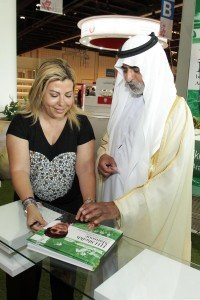 Lara Sawaya shows Yearbook to Sheikh Nahyan bin Mubarak Al Nahyan