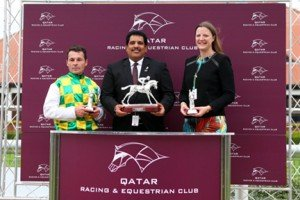 ARO Racing Manager collects the trophy on behalf of winning connections from QREC General Manager Sami Al Boenain