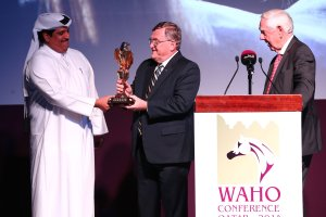 QREC General Manager, Sami Al Boenain, gives Peter Pond a thank you.