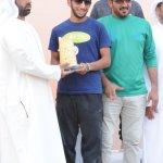 Ahmed Yousef Al Baloushi with H.E. Ali Abdullah Al Rumaithi and Assistant Trainer Mohammed Nasser.