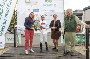 Karin van den Bos stands with winning jockey and Margreet de Ruiter