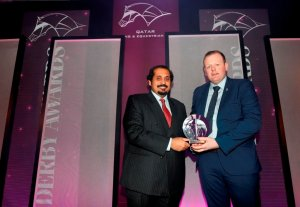 QREC General Manager Nasser Sherida Al Kaabi presents Gary Capewell with his award.