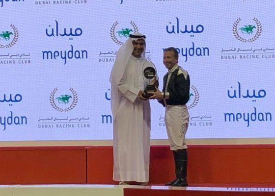 O'Shea accepting the trophy for the 2019 Kahayla Classic win on AF Maher