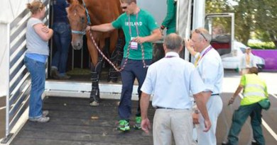 Ireland team rider Mark Kyle unloads one of the horses at the Equine Staging Facility.