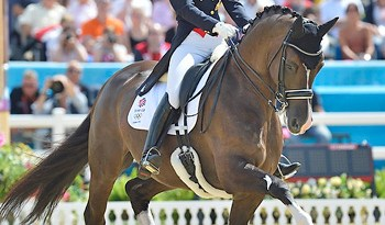 Charlotte Dujardin and Valegro produced an Olympic record-breaking score in the Dressage Grand Prix to give Great Britain a marginal advantage over Germany going into the Grand Prix Special on Tuesday, which will decide the fate of the Dressage team medals.
