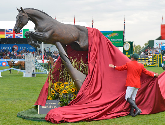 Eric Lamaze unveils the Hickstead Statue at Spruce Meadows.