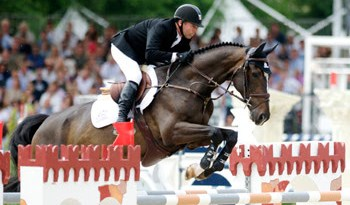 Eric Lamaze claimed his second consecutive five-star grand prix victory, the €200,000 Grand Prix of Rome, on Sunday, riding Zigali P S.