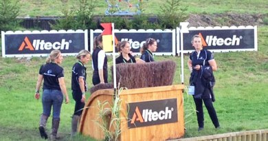 New Zealand team members walking the course.