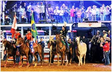 Filipe rides into the Barretos rodeo arena to the cheers of 60,000 people.