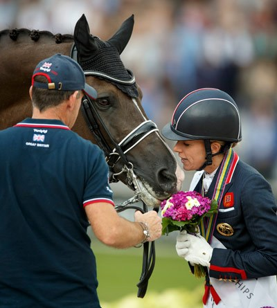 GP Special gold medalist Charlotte Dujardin shares a moment with Valegro after their winning performance in Aachen.