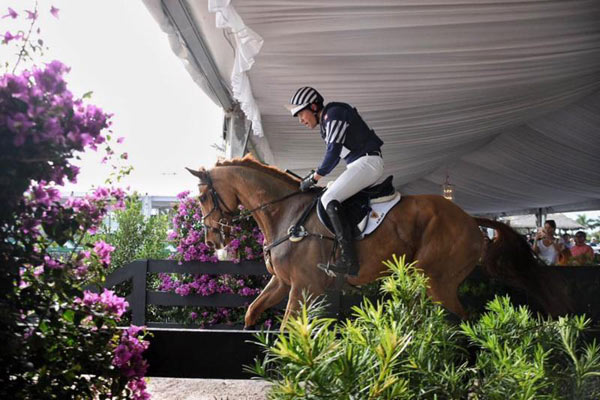Boyd Martin and Blackfoot Mystery ride through the VIP tent at the $75,000 Asheville Regional Airport Wellington Eventing Showcase presented by Wellington Equestrian Realty.