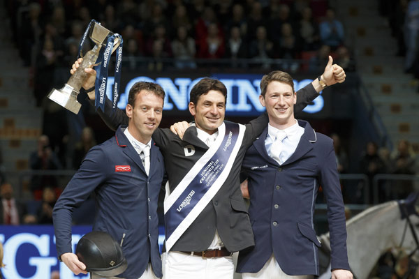 Steve Guerdat gives a big thumbs up on the podium after winning the Longines FEI Jumping World Cup in Gothenburg. At left is runner-up Harrie Smolders, and at right is third-placed Daniel Deusser. © Hippo Foto - Dirk Caremans
