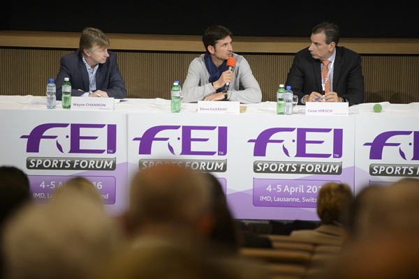 Olympic showjumping champion Steve Guerdat), centre, speaks at the FEI Sports Forum in IMD, with rapporteur Wayne Channon, of Britain, and fellow panelist Cesar Hirsch, of Venezuela. Photo: FEI/Richard Juilliart