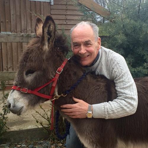 New Brooke patron Alastair Stewart OBE with Hobnob.