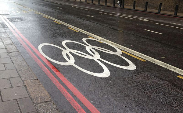 Olympic rings marked on a street in London, indicating that the lane was reserved for the use of Olympic athletes and staff.