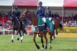 Michael Jung leads Andreas Ostholt and Gemma Tattersall in their victory lap for the Badminton Horse Trials.