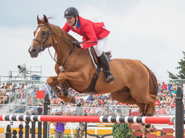 Two-time Olympic gold medallist McLain Ward (USA), the new world number one in the Longines Rankings, with Rothchild at the OLG Caledon Pan Am Equestrian Park during the Toronto 2015 Pan American Games in Caledon, Ontario.