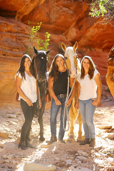 Kelly, Vicki and Amanda with their mustangs during the 100 days they spent taming wild horses in the American West.