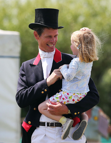 William-Fox Pitt with his daughter Chloe after completing the CCI2* dressage test on Top Biats at Tattersalls on Friday.