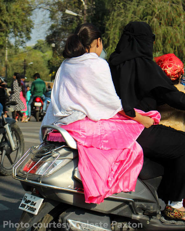 The trip offered Paxton a chance to experience the vibrant pageantry of rural Indian life, including this family outing aboard a moped.