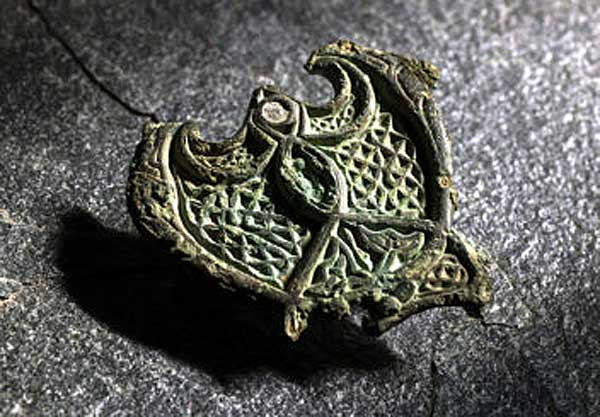 A female Norwegian Viking who died during the 9th century was buried wearing a status symbol: this repurposed piece of bronze jewellery which was most likely originally created as a fitting on horse harness. Photo:Norwegian University of Science and Technology