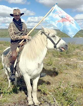New Zealand Ian Robinson departs on his Siberian journey. He is photographed with the flag of the Long Riders' Guild.
