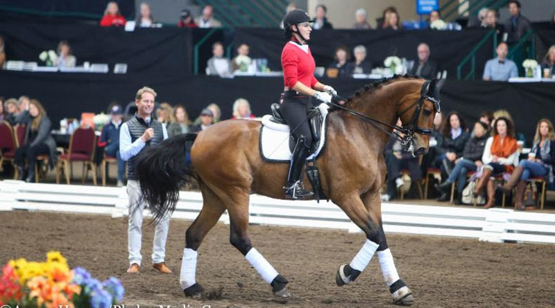 Carl Hester puts small tour combinationTiffany Mahoney and Rey Del Mundo through their paces.