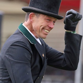 Jonty Evans celebrates after posting a sub-40 dressage score on Cooley Rorkes Drift at Badminton.