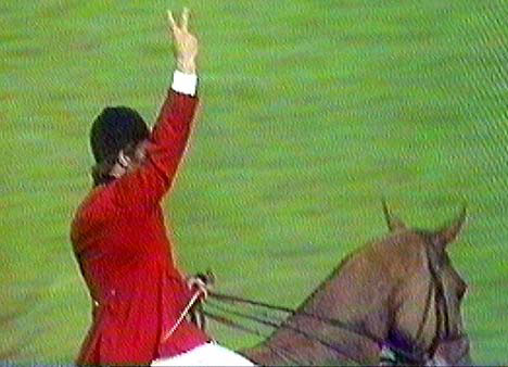 "Harvey Smith's infamous ""victory"" gesture after winning the Hickstead Derby for the second year in succession in 1971."