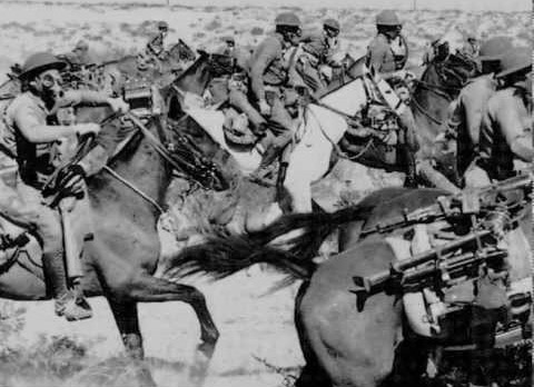 A cavalry charge in WWI, with the soldiers wearing gas masks.