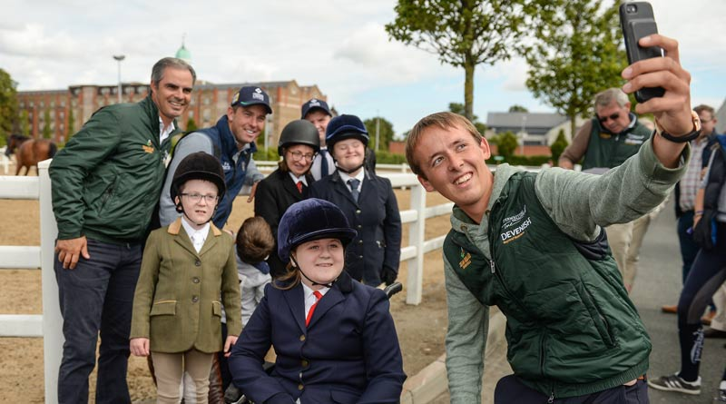 Bertram Allen takes a selfie of he and team-mate Cian O'Connor and Chef d'Equipe Rodrigo Pessoa with, from left, Oisin O'Connell, 7, from Clashmore, Co Waterford, Lynn Frain, from Mullingar, Co Westmeath, Niamh Carolan, from Navan, Co Meath, Stephen Power, from Dungarvin, Co Waterford, and Gemma Haire, 17, from Inistioge, Co Kilkenny.
