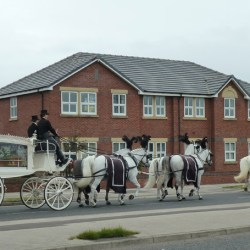 Horse-drawn funeral procession in Blackpool, England.