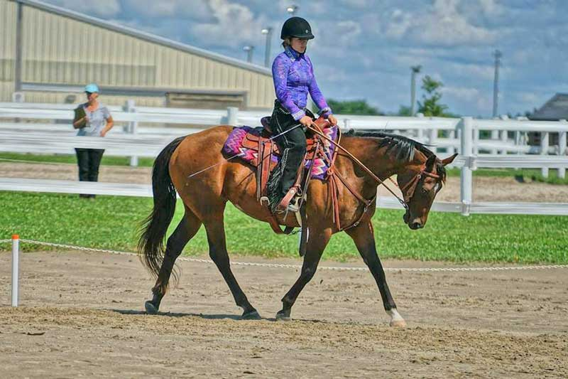 """Sydney Standing with Rosie: """"Thoroughbreds have so much to offer and put their hearts into everything that they do."""""""