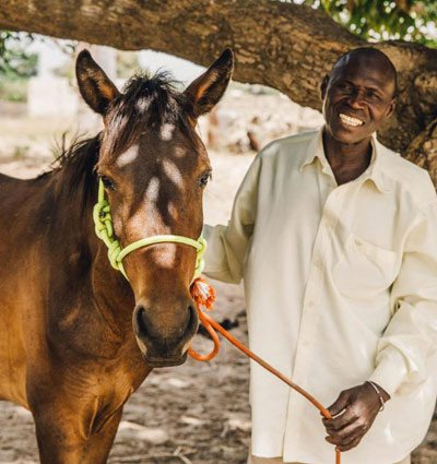 A happy horse and owner with a new rope halter.