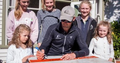 Jock Paget signs ribbons for Evie, right, and Greta Dale, with Amanda Shallard, Abi Hyslop and Cate Lightbourne at the fundraiser for the new eventing course.