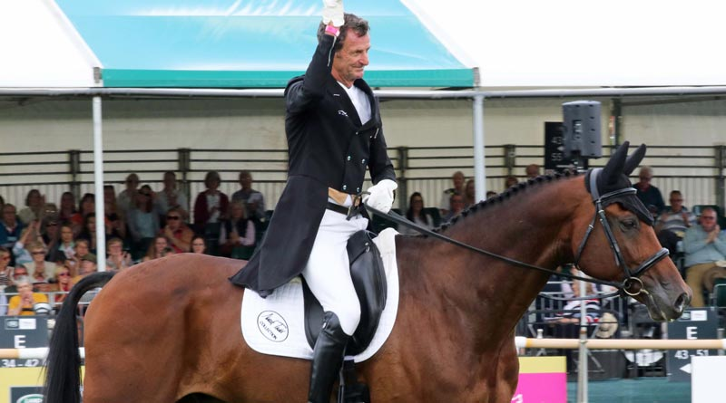 Mark Todd and Leonidas lead after the dressage phase at the Burghley Horse Trials.