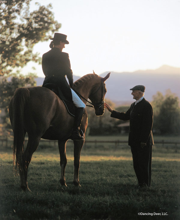 Dressage Master Walter Zettl pictured with Premier Equestrian President Heidi Zorn riding Pink Panther.