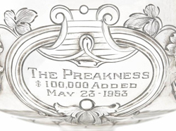 One of the four engraved cartouches on the 1953 Preakness Stakes trophy.