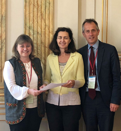 Brooke CEO Petra Ingram, left, with Dr Monique Eloit. and World Horse Welfare CEO Roly Owers with the Letter of Intent from the ICWE at theWorld Organisation for Animal Health's General Session in Paris.