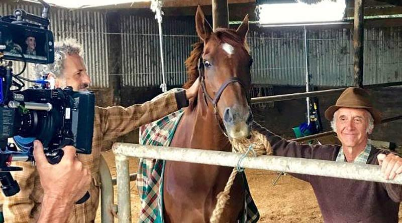 Nick Blake as Snow Lupton with one of the three horses who played Kiwi a film about the Melbourne Cup winner.