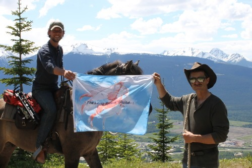 Filipe learns about horse packing from Canadian Long Rider Stan Walchuk in 2012.
