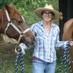 Celeste Carlisle with her horses, Tishka, left, and Sammy.