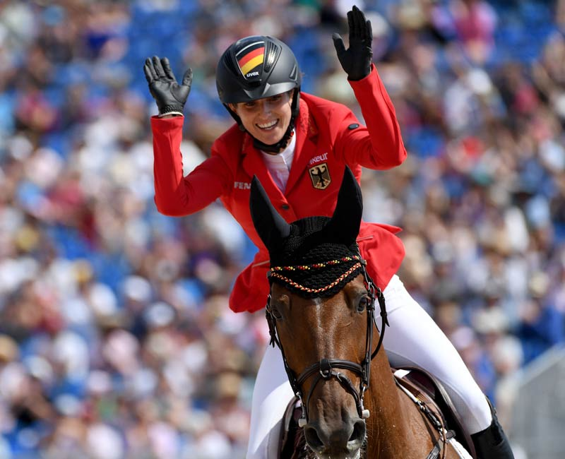 Germany's Simone Blum celebrates winning the Individual Jumping title at the FEI World Equestrian Games in Tryon, USA with DSP Alice. © FEI/Martin Dokoupil