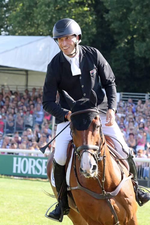 Tim Price is all smiles after his clear round on Ringwood Sky Boy at Burghley.