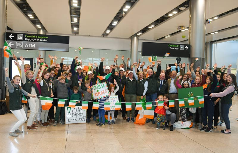 Supporters, families and friends welcome the Irish eventing team home at Dublin Airport.