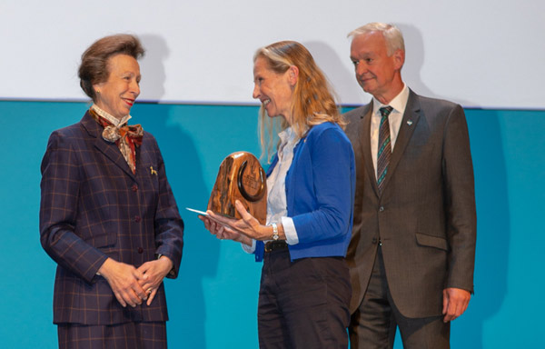 Deidre Carson receiving The BEVA Equine Welfare Award sponsored by Blue Cross award on behalf of Peter Rossdale, from Princess Anne, with Blue Cross vice-chairman Steve Swift.