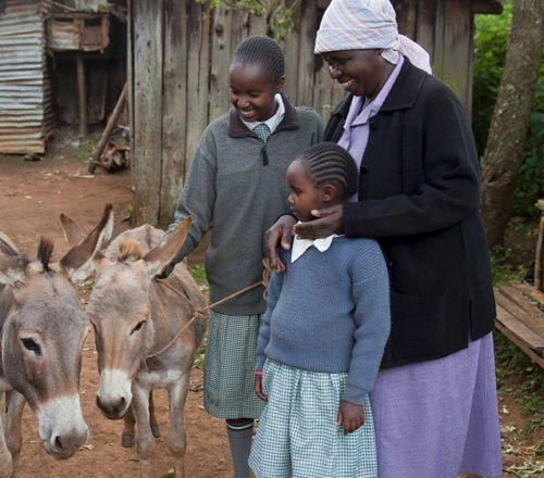 Access to the new water tank has reduced the wait time for locals collecting water, including Lenah Nzuki and her donkeys.